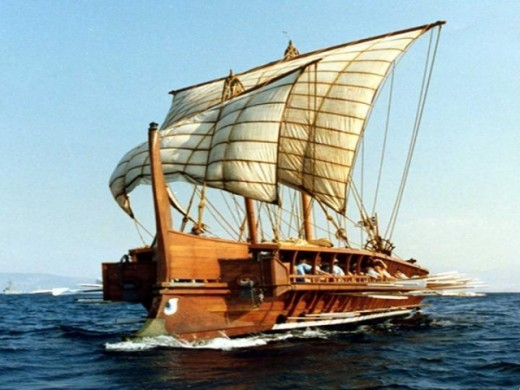 This is either a Bireme or a Liburnia. Either way, it's an ancient Greek warship and it looks badass as hell. This is one of the cases where the big, billowing sails look right on this type of ship